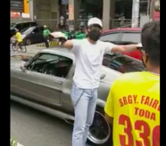 Daniel gives money to tricycle driver who hit his car